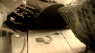wwii soldier typing condolence letter focus on dog tags video