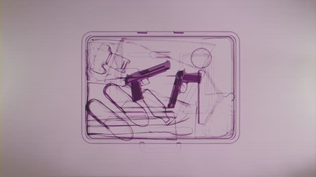 X-ray image of suitcase with weapons video