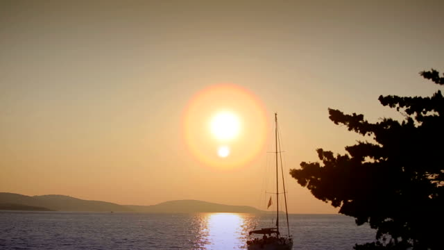 yacht in the sea at sunset video