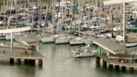 Yachts comes and go in the marina of Barcelona video
