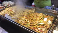 Yakisoba in the big pan ,Myeongdong street food , Seoul , South Korea. video