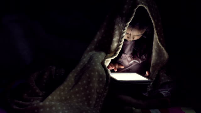5 years old girl using a digital tablet in the dark video