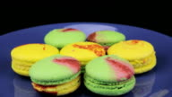 Yellow and green macaroon rotate on a plate video