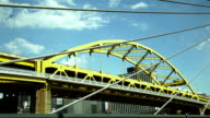 Yellow bridge view through steel beam ropes background video