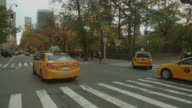 Yellow caps driving in Central Park 5th Avenue NYC video