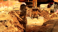 Yellow excavator at building site. video