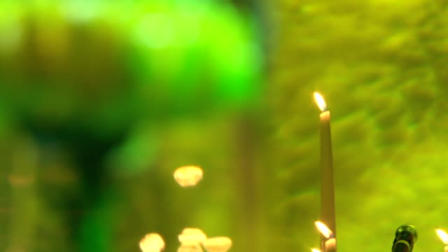 Yellow flower near candle video