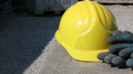 Yellow hard hat and gloves video