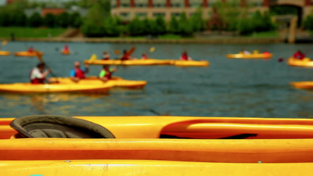Yellow kayak near the river - close up background video
