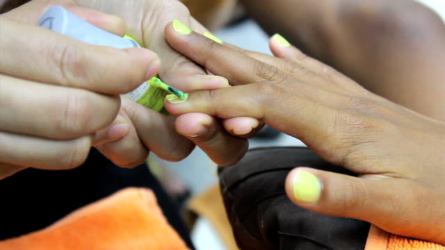 Yellow Paint On Finger Nails During Manicure video