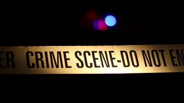 Yellow police Crime scene tape corden & siren in background video