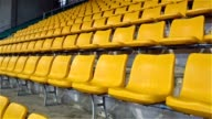yellow stadium seats zooming in video