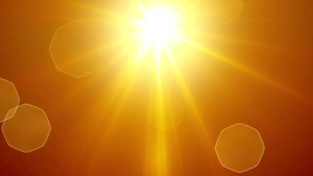 yellow sun rays and lens flare loopable background video