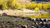 Yellow tent near mountain river video