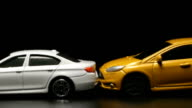 ACCIDENT: Yellow toy model car crashes to white toy car (slow motion) video