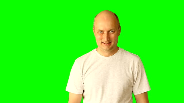 Yes no do not know happy smile - gestures at green screen. Adult caucasian man close up view upper half portrait. Clip with premultiplied matted Alpha Channel. Transparent background PNG format. video