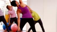 Yoga class in fitness studio video