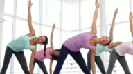 Yoga class in fitness studio video