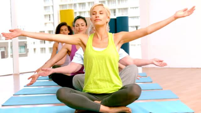 Yoga class raising their hands video