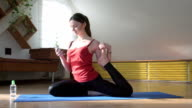 Yoga girl in dove position chatting online video