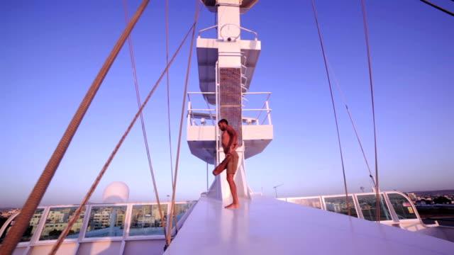 Yoga on ship - Standing Bound Half Lotus Forward Bend video