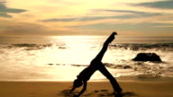 Yoga stretch at sunset - HD video