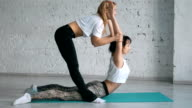 Yoga Trainer Helps Female Student To Stretch Back, Sport Practice With Partner video