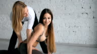 Yoga Trainer Helps Female Student To Stretch Legs And Do The Splits video