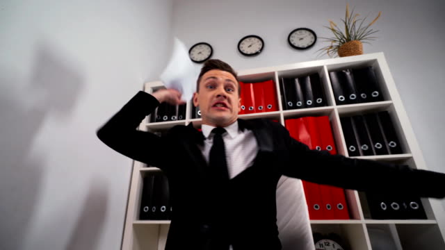 You are fired Angry businessman in formal wear shouting to person showing finger to exit video