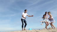 Mother and Father Spinning Their Son and Daughter on the Beach video