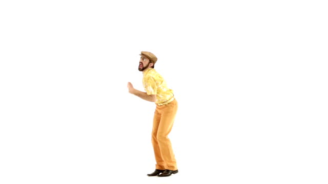 Young 70s bearded man dressing hat and yellow floral orange vintage shirt dances on 103 bpm music track - isolated-on-white HD video footage video
