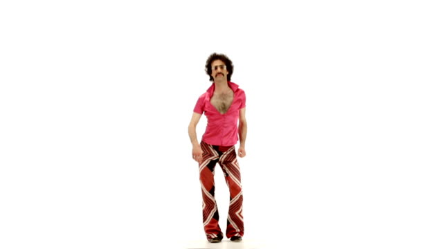 Young 70s curly hair man dressing fuchsia vintage shirt and bell bottoms dances on 103 bpm music track - isolated-on-white HD video footage video