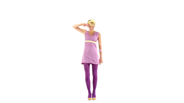 Young 70s seductive woman dressing purple vintage dress make dance steps on 103 bpm music track - isolated-on-white HD video footage video