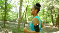 Young adult African American athlete running off road during workout video