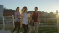 Young adult business professionals walking in city video