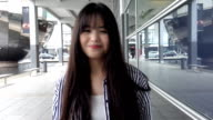 young adult chinese woman walking toward the camera video