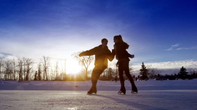 Young adult couple skating together. video