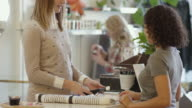 Young adult female purchasing an item in a clothing and retail store video