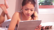 Young adult female reading studying in bedroom video
