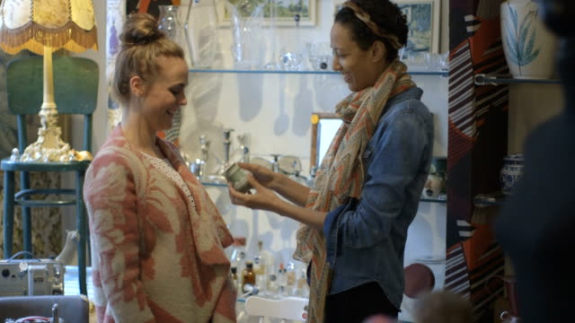 Young adult friends shopping in second-hand store video