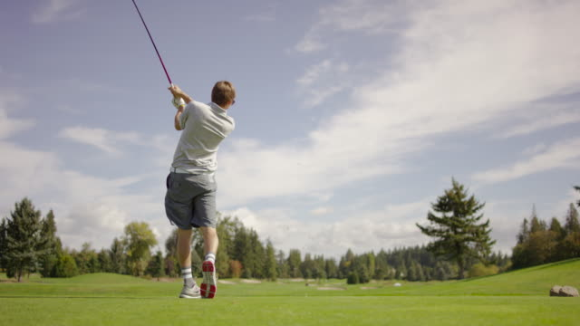 Young adult golfer teeing off video
