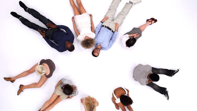 Young adult group looking up video