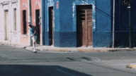 Young adult male rollerblade in urban street video