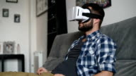 Young adult man and a virtual reality headset.Guy using vr glasses video