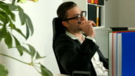 Young adult manager is sitting and thinking in the office video