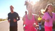 Young adult multi-ethnic group of athletes running outdoors video