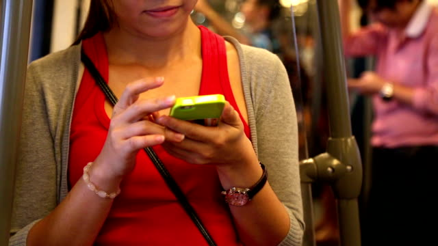 Young Adult playing Smart phone video