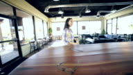 Young adult woman shaking hands with friend or manager in local coffee shop video