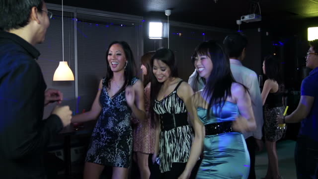 Young adults at an Asian nightclub video