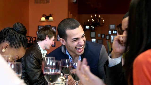 Young Adults Laugh at Busy Restaurant video